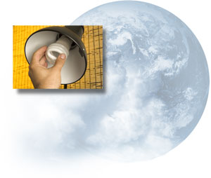 A CFL being screwed into a desk lamp; earth, as seen from space, partially covered by clouds.