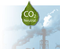 CO2 Neutral on a green leaf; emissions at an industrial plant.