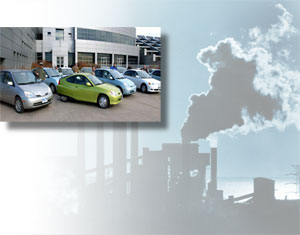 A fleet of 'green' cars; a silhouette of emissions at an industrial plant.